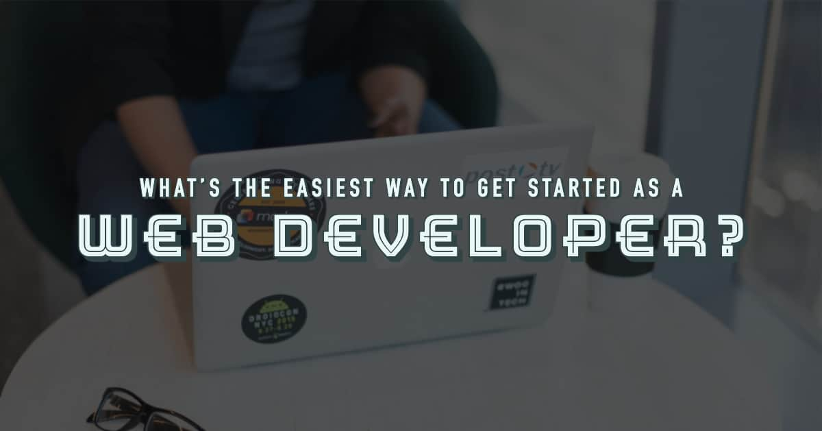 Person At Computer Researching To Become A Web Developer