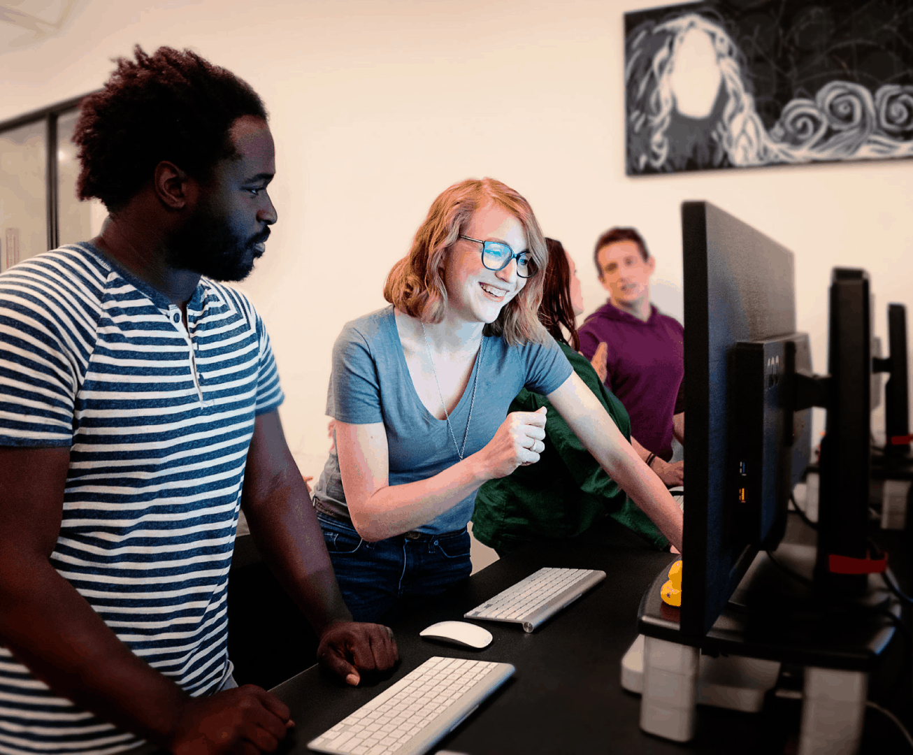 Diverse Group Of Coders At Computers
